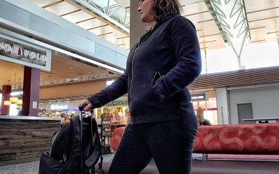 stay safe and organized as a solo traveler woman in YYC airport