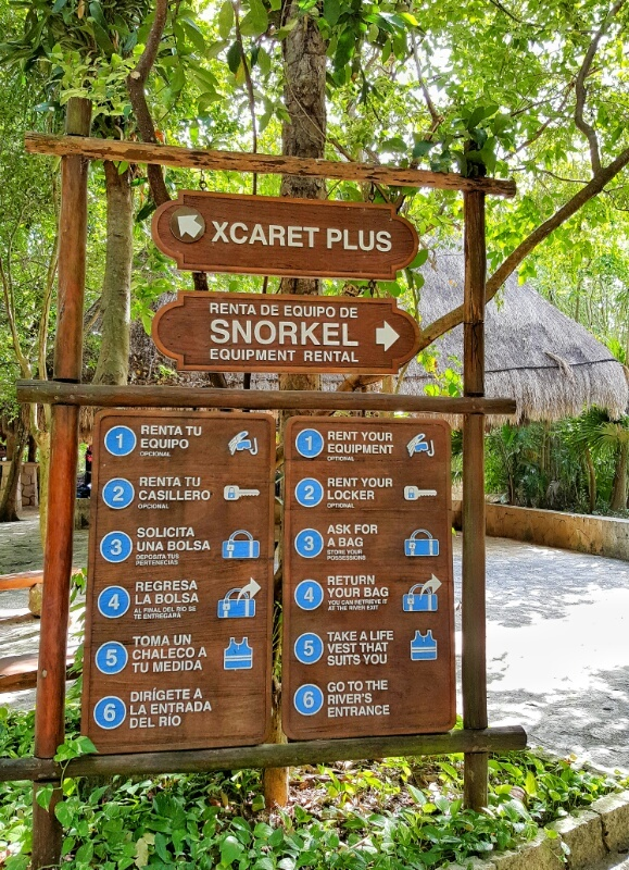 Xcaret Plus signs snorkel locker life vest river entrance
