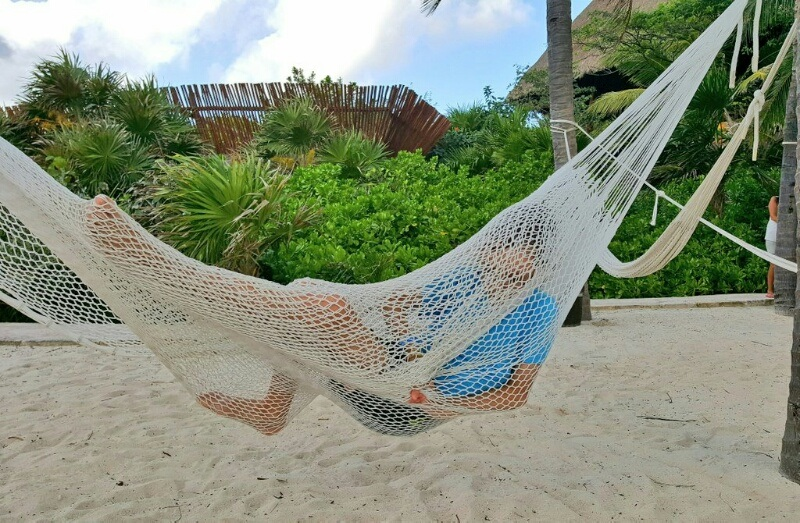 Xcaret kid playing in hammock