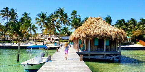 Girl running down the dock at Victoria House Belize