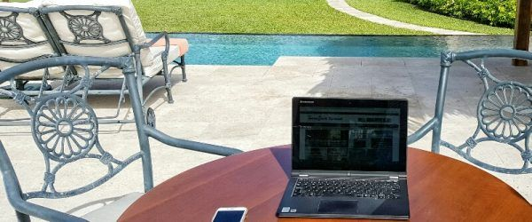 Laptop by pool and ocean Victoria House Belize