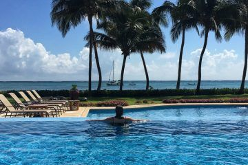 Looking out over the ocean at the infinity pool The Phoenix Belize Resort