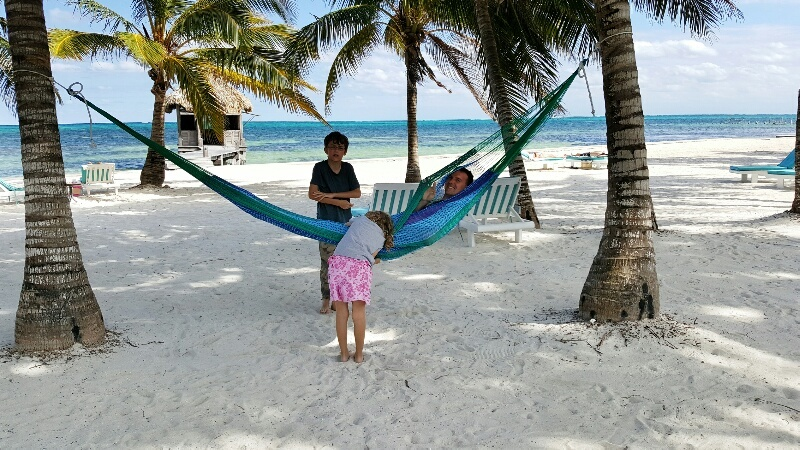 Playing in the hammock at Victoria House Belize