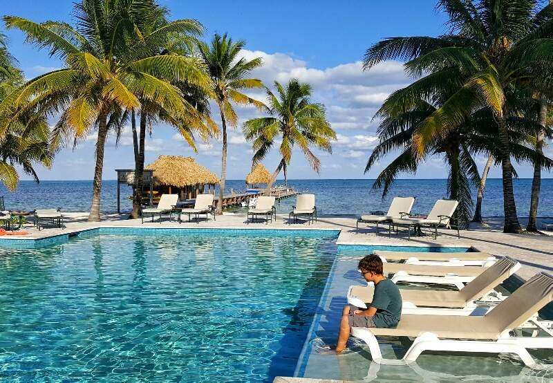 Relaxing in the pool facing the ocean at Victoria House Ambergris Caye
