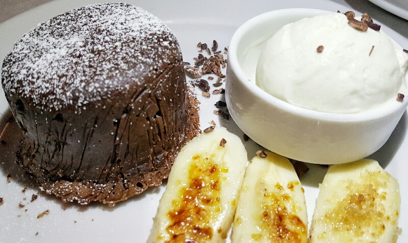Savoring desserts bananas with chocolate lava cake Victoria House Belize