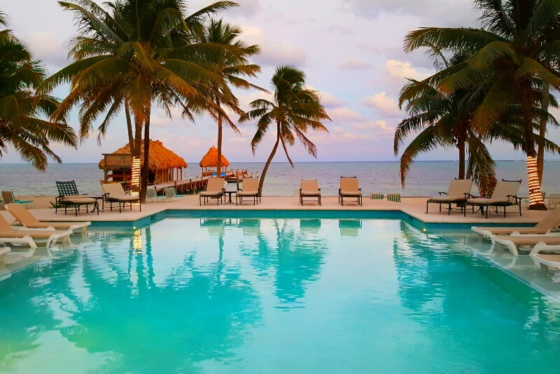 Sunset by the pool Victoria House Belize