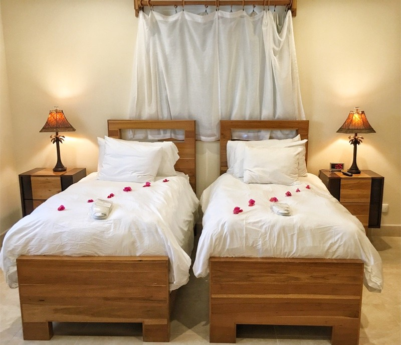 Two single beds at The Phoenix Belize Resort