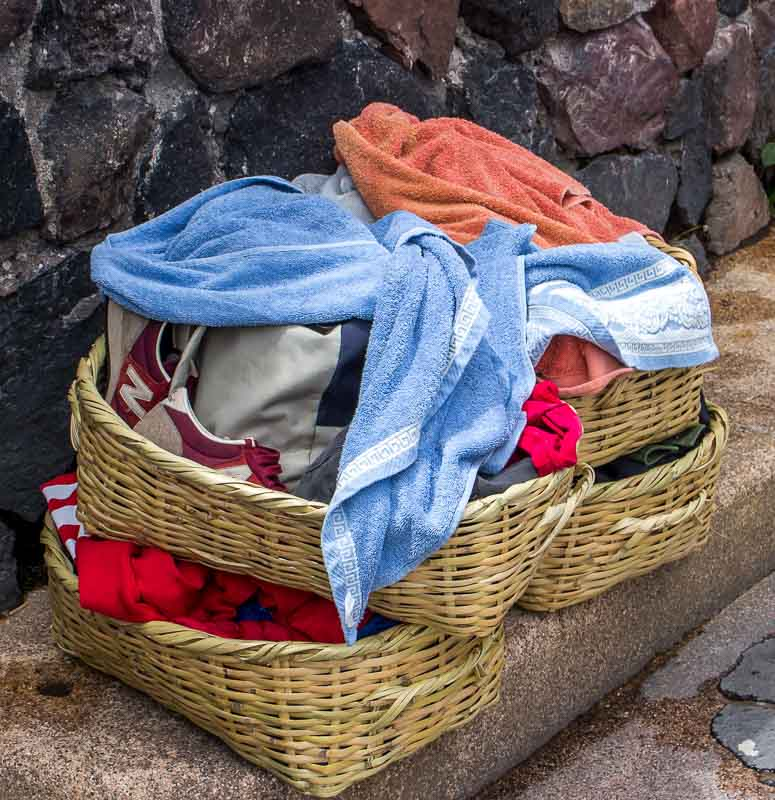 Wicker baskets for belongings in public hot pools Papallacta