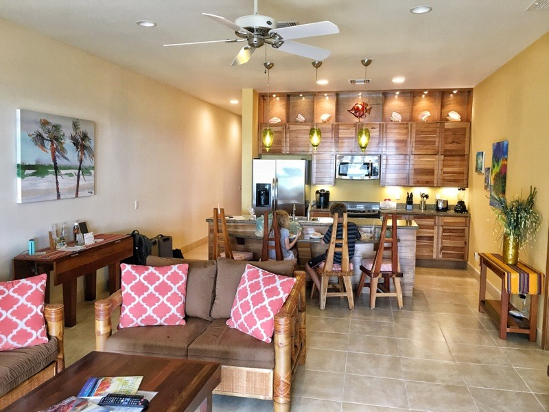 living room and kitchen in two bedroom suite at The Phoenix Belize Resort