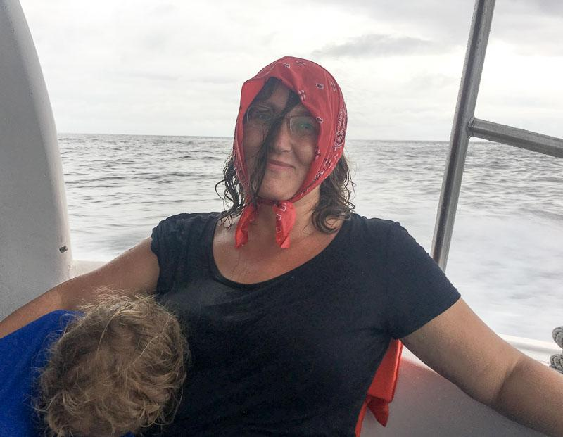 Micki soaking wet on ferry to Santa Cruz Galapagos