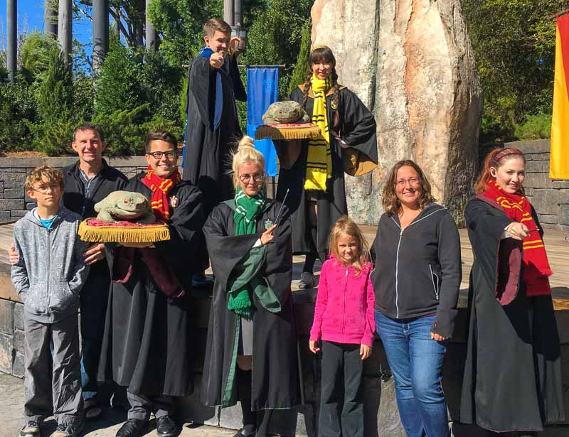 The Wizarding World of Harry Potter family with the frog choir show