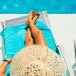 Tips to beat the heat this summer woman in lounge chair by pool