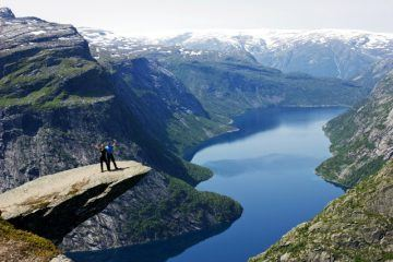 Couple on top of Trolls Tongue Trolltunga in Norway DP