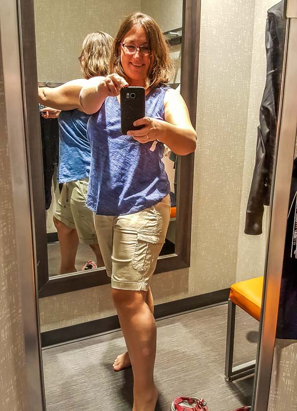 Happy in the fitting room trying on Marks casual clothing