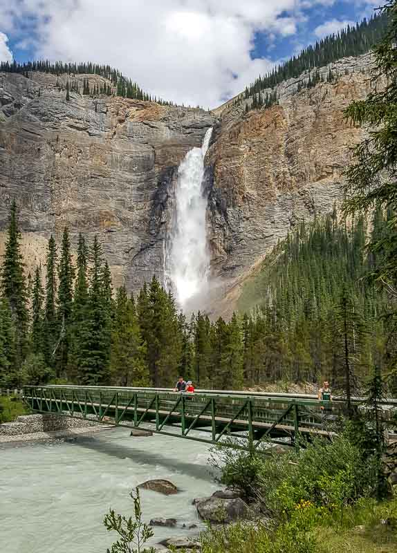 Walking across the bridge at Takakkaw Falls