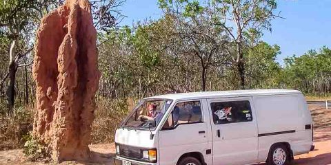Van and termite mound in Australia