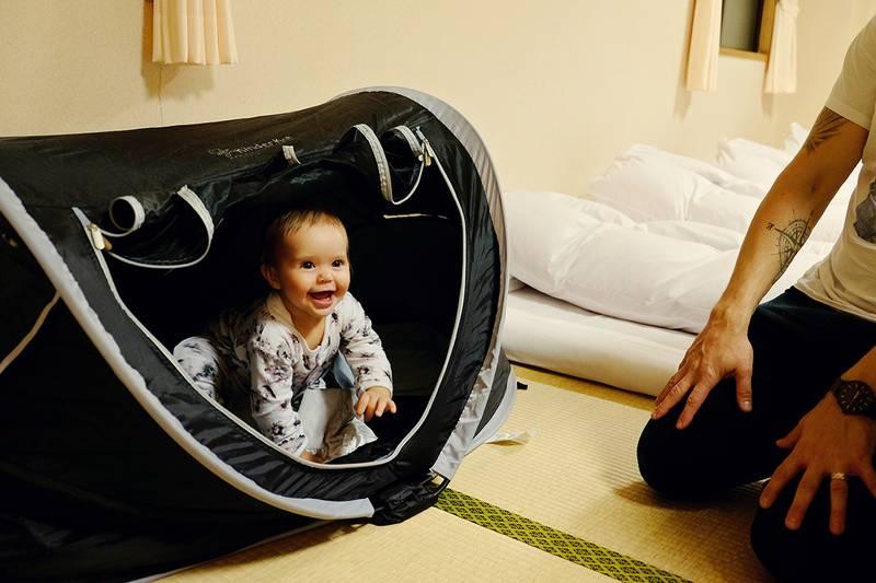 Avie in her Travel Bed