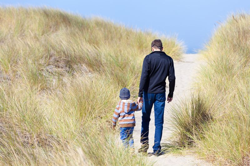 Oregon Dunes boy and dad walking