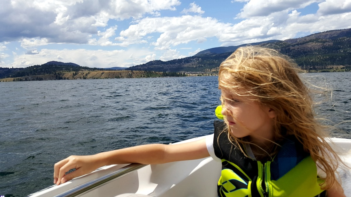 Girl on a boat lake Okanagan