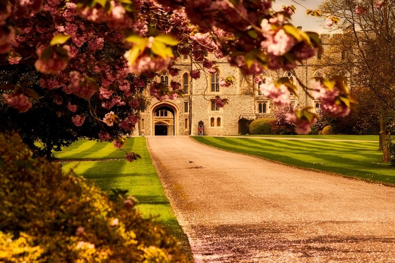 Windsor Castle England with fall foliage and guard in background