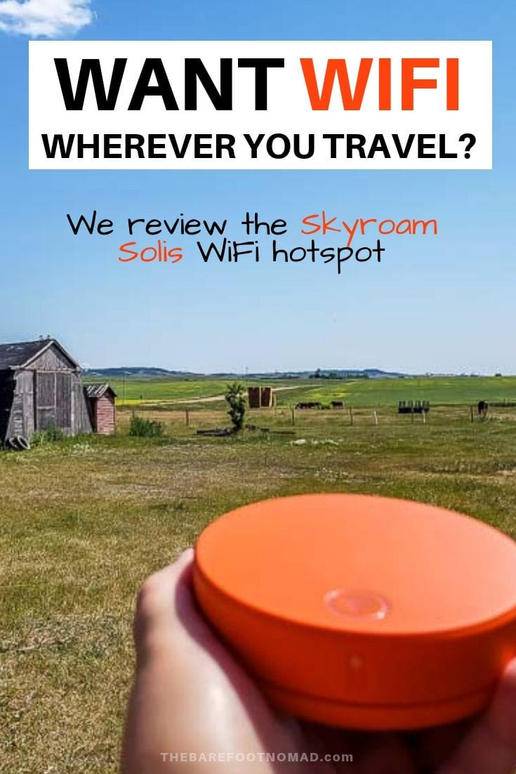 Skyroam Solis portable WiFi in prairie field with barn in background