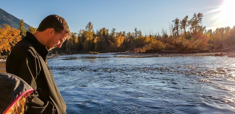 man and girl looking at Sockeye salmon spawning in the Adams River British Columbia