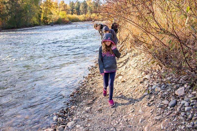 girl walking by the Adams River at Tsutswecw Provincial Park British Columbia