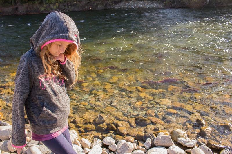 girl walking along Adams River British Columbia during the Sockeye salmon run