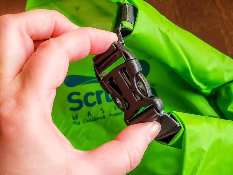 Scrubba portable laundry bag with top buckle closed