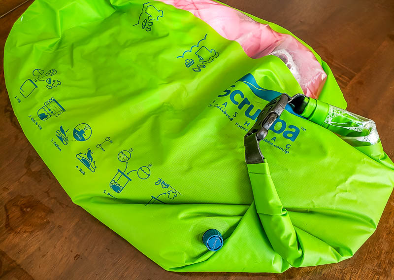 Scrubba review - using the Srubba wash bag with laundry inside with clear window to view laundry inside