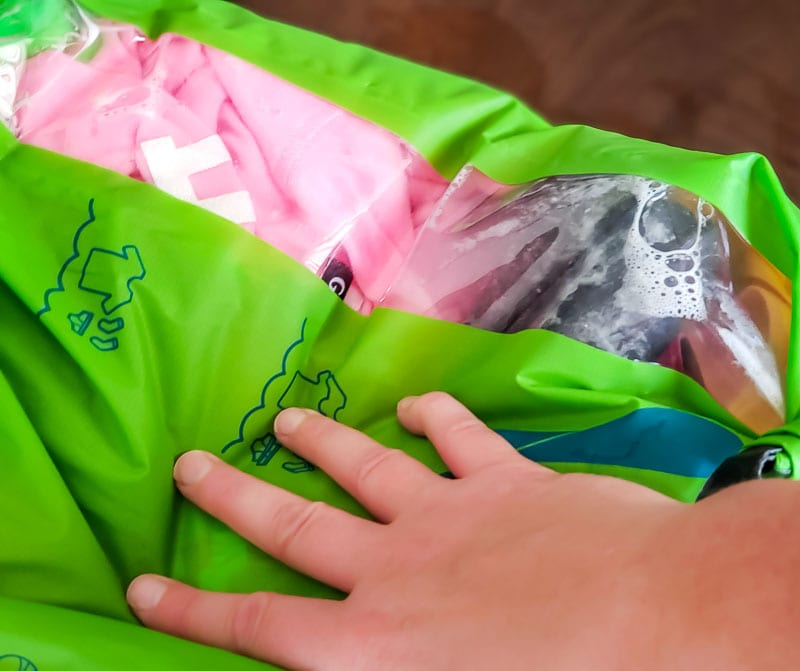 Our Scrubba review doing laundry hands on with bubbles inside the bag
