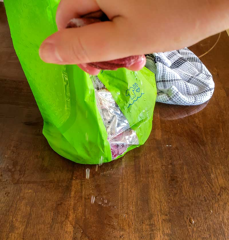 Scrubba review - washing out wet clothes after rinsing in the Scrubba wash bag
