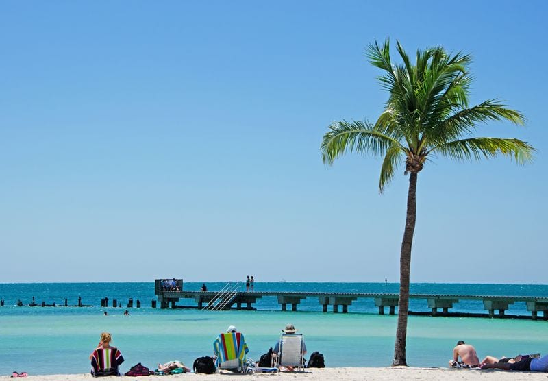 People overlooking boardwalk on beautiful Higgs Beach Key West DP one of the very best beaches in the Florida Keys USA