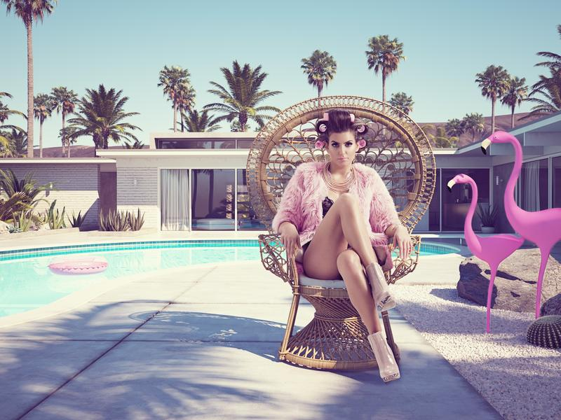Palm Springs a great weekend escape from LA - pic of flamingos and woman in curlers by the pool