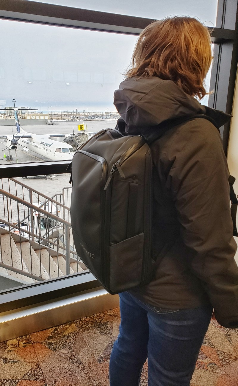 Nomatic backpack on woman airport