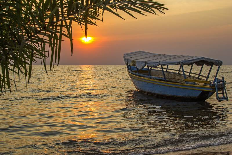 moored boat at sunset Lake Victoria Tanzania