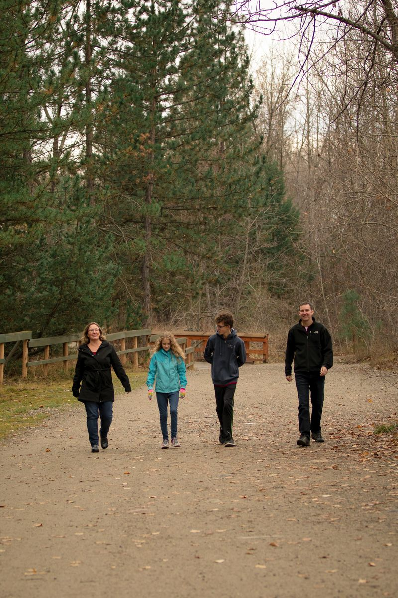 Family walking in Mission Creek Kelowna British Columbia