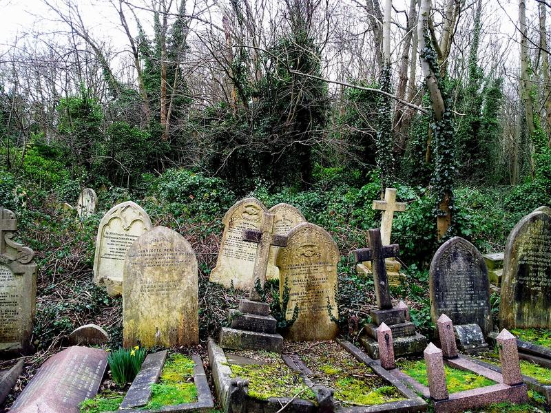 tombstones at Highgate Cemetary in London England PXBY