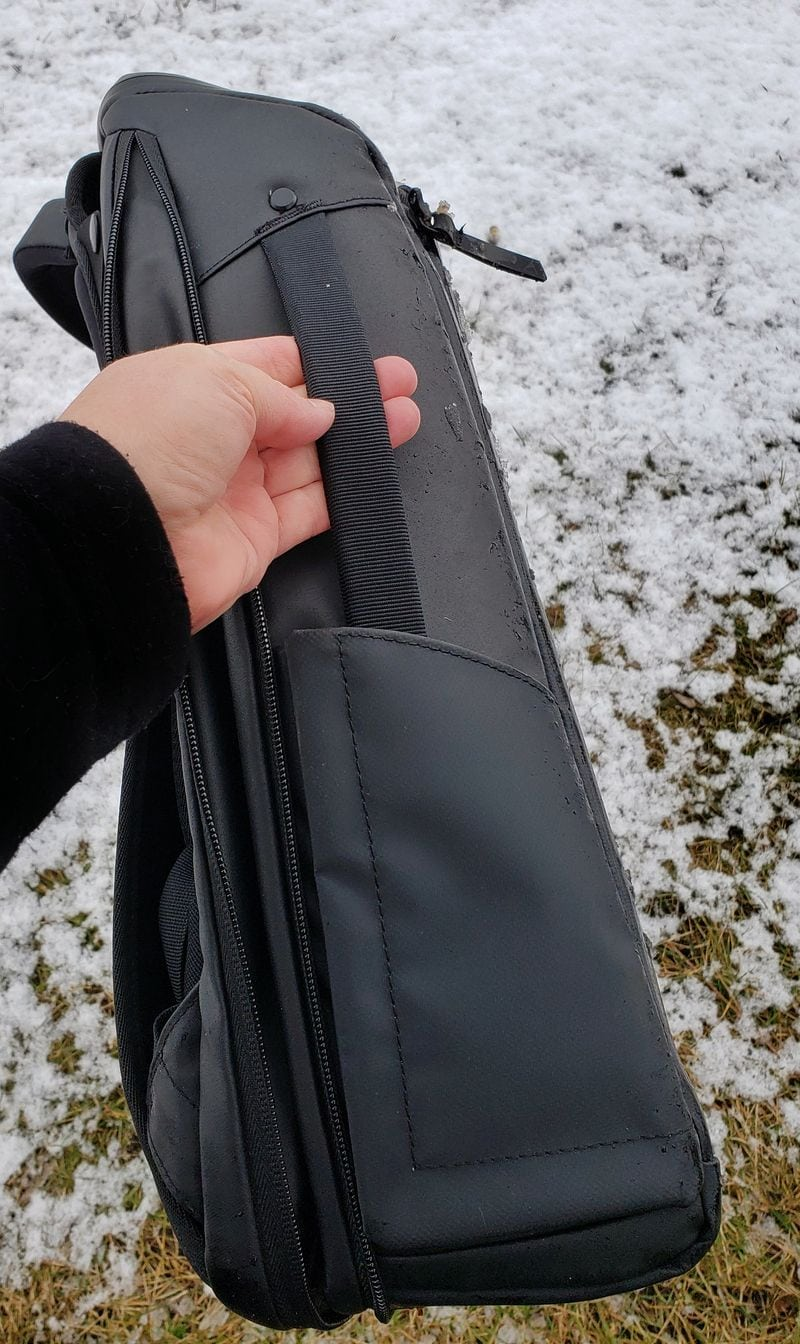 Nomatic backpack in briefcase mode with straps tucked away