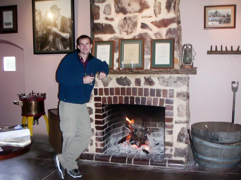By the fireplace at Front door of Wolf Blass Winery Australia with winemaking equipment nearby
