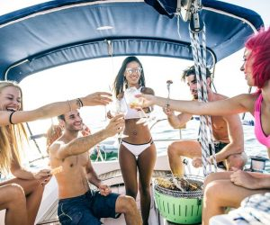 friends partying on a boat