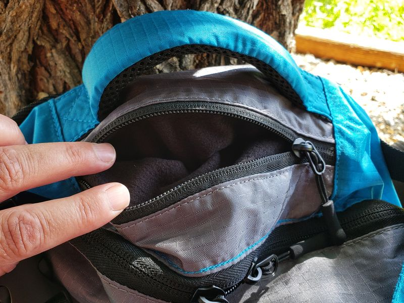 small pocket for wallet or passport at top of Twin Lakes Paxis backpack