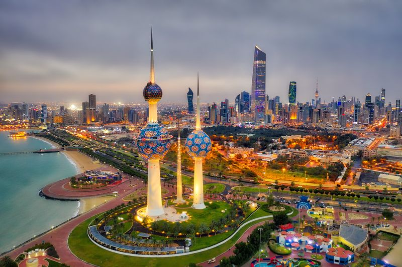 Places to visit in Kuwait, with Kuwait Tower City Skyline glowing at night